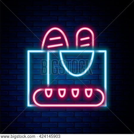 Glowing Neon Line French Baguette Bread Icon Isolated On Brick Wall Background. Colorful Outline Con
