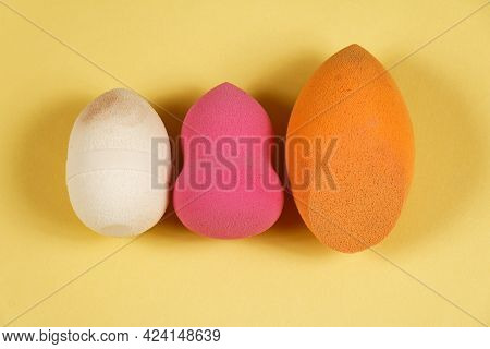Colorful Foam Sponges Makeup Beauty Tool Accessory In A Row On Yellow Background