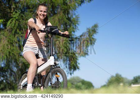 Portrait Of Beautiful Happy Girl, Young Sportive Fit Positive Woman Riding Electro Bike, Electric Bi