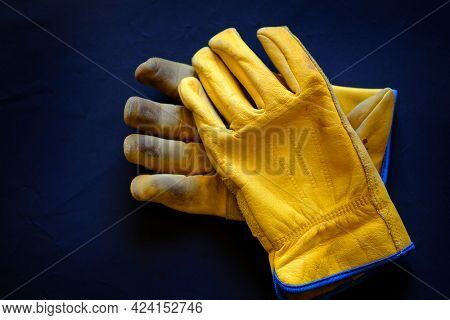 Detail of old worn leather work gloves workgloves texture