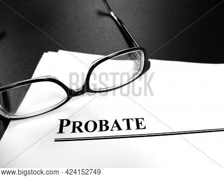 Probate last will and testament Estate Planning documents on desk with glasses