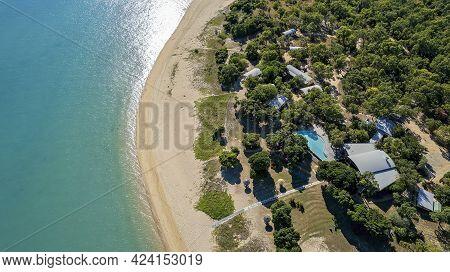 Cape Gloucester, Queensland, Australia - June 2021: Aerial View Over A Bushland Beachfront Resort Wi