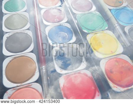 A Set Of Watercolors Of Different Colors For Painting. Multi-colored Round Containers With Bright Pa