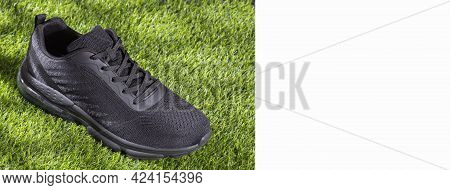 Sports Shoe On Synthetic Grass - Text Space