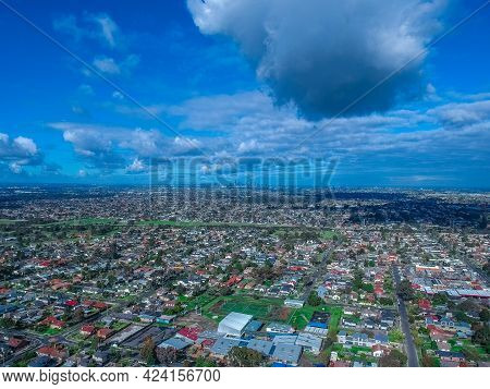 Panoramic aerial view of Melbournes western suburbs and CBD looking down at Houses roads and Parks V