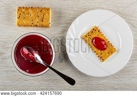 Crackers With Flax Seeds, Teaspoon In Glass Bowl With Cherry Jam, Cracker Poured Jam In White Plate