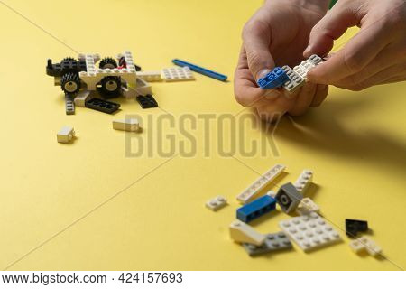 A Child Playing With Toy Constructor Pieces, Education And Learning