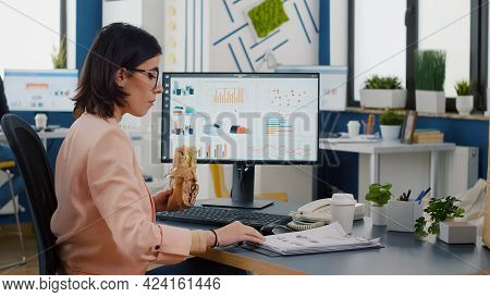 Businesswoman Having Delivery Lunch Food Order During Takeaway Lunchtime Working In Business Company