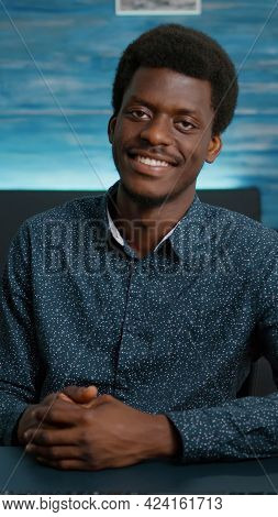 Portrait Of Handsome African American Man Looking Into Camera, Smiling Young Black Man In Cozy Moder