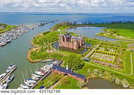 Aerial from the medieval Muiderslot castle at the IJsselmeer in the Netherlands