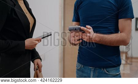 Delivery Man Delivering Food Order Takeaway To Businesswoman In Startup Company Office During Luncht