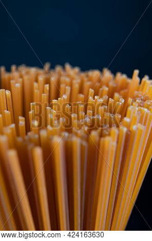 A Bunch Of Red Tomato Pasta. Colored Spaghetti.
