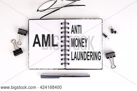 Notebook With Anti-money Laundering Aml With Glasses And Office Tools,, Business