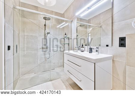 Interior Of Small Clean Bathroom In Miniature Style