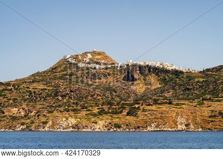 Plaka Town On Milos Island, Greece, Situated On A Hill With Row Of Traditional Whitewashed Cycladic