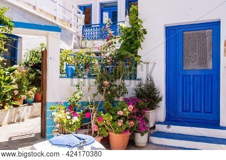 Plaka Town On Milos Island - Picturesque Narrow Stone Street With Traditional Greek Whitewashed Wall