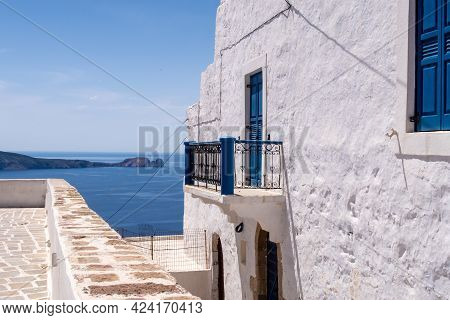 Sea View From Plaka Town On Milos Island, Greece, With Whitewashed Traditional House With Blue Windo