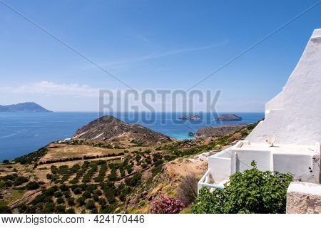 Sea View From Plaka Town On Milos Island, Greece, With Whitewashed Traditional Houses And Green Vine