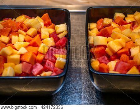 Freshly Cut Fruits In A Black Bowl