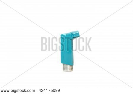 Close Up Of A Blue Asthma Inhaler Isolated On The White Background