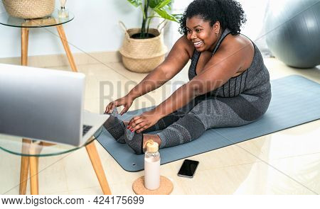 Young African Curvy Woman Doing Pilates Online Fitness Class With Laptop At Home - Sport Wellness Pe