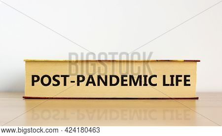 Covid-19 Post-pandemic Life Symbol. Concept Words 'post-pandemic Life' On Book On Wooden Table. Beau