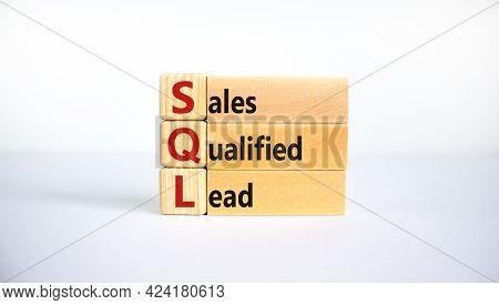 Sql Sales Qualified Lead Symbol. Wooden Blocks With Words 'sql Sales Qualified Lead'. Beautiful Whit