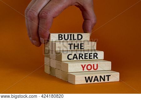 Build Good Career Symbol. Wooden Blocks With Words 'build The Career You Want'. Businessman Hand. Be
