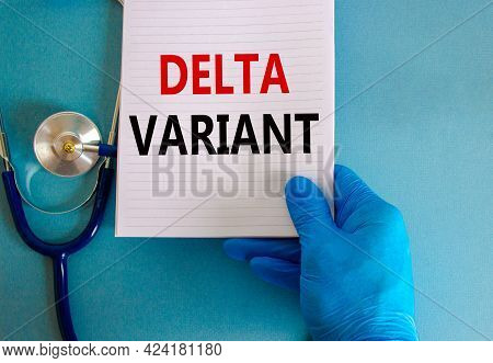 Covid-19 Delta Variant Strain Symbol. Doctor Hand In Blue Glove With White Card. Concept Words 'delt