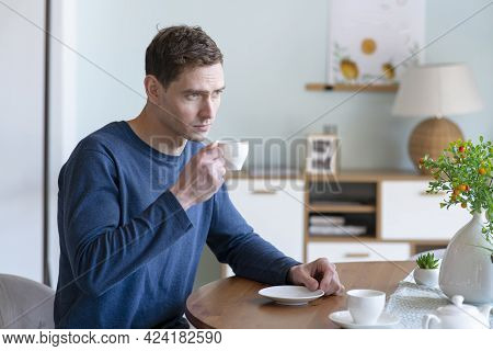 Portrait Of Sad Pensive Thoughtful Unhappy Guy, Young Handsome Upset Tired Man Drinking Hot Coffee O