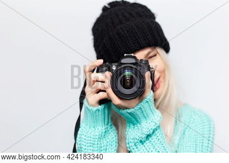 Portrait Of Pretty Blonde Girl, Photographer Taking Photo On Dslr Camera, On White Background. Weari