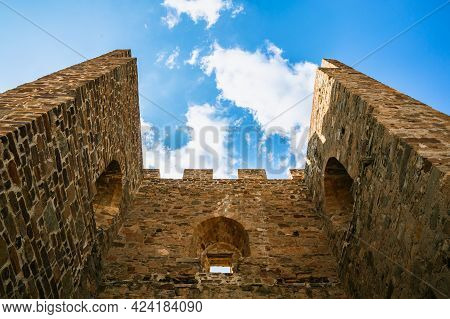 Genoese Fortress In Sudak Crimea Stone Walls And Tower Of An Ancient Fortress Bottom View