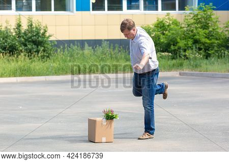 Enraged Man Kicks A Box Of Personal Belongings After Being Fired.