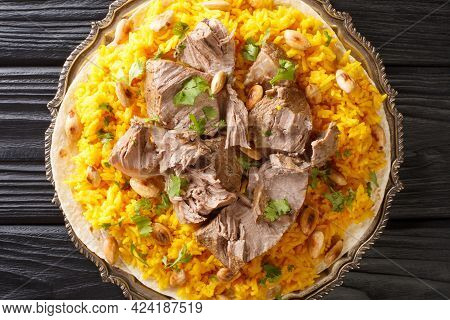 Mansaf Is A Dish Of Rice, Lamb, And A Dry Yoghurt Made Into A Sauce Called Jameed Closeup In The Pla