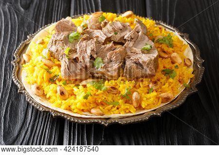 Jordan National Dish Mansaf Made Of Lamb Meat Jameed Yogurt, Rice Closeup In The Plate On The Table.