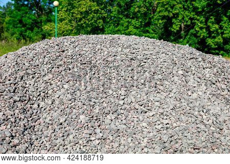 A Pile Of Rubble On A Background Of Green Trees, It Is Summer