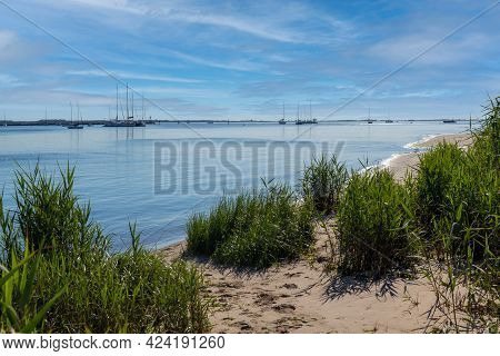 A View Of Sailboats On Sandy Hook Bay From The Atlantic Highlands Shoreline In New Jersey.