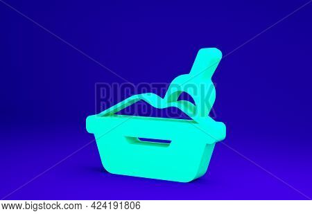 Green Cat Litter Tray With Shovel Icon Isolated On Blue Background. Sandbox Cat With Shovel. Minimal