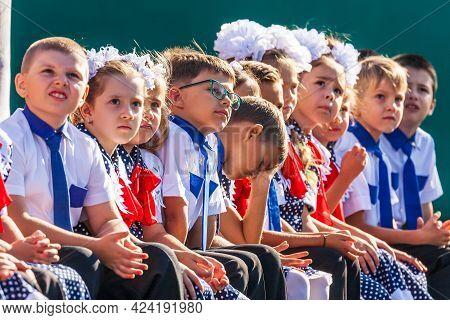 Krasnodar, Russia - September 1, 2020: First-grade Schoolchildren Sitting In Row At Holiday Of Begin