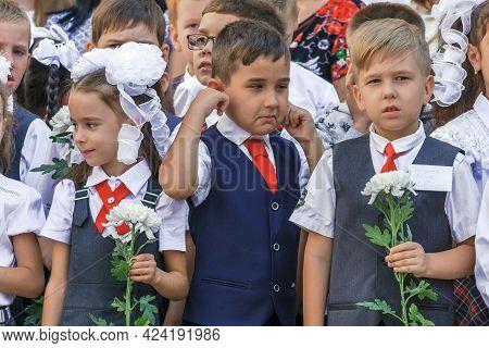 Krasnodar, Russia - September 1, 2020: First-grade Schoolchildren Standing In Row At Holiday Of Begi