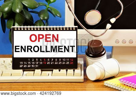 Open Enrollment. Text Inscription In The Calendar On The Background Of Medicines And A Stethoscope.