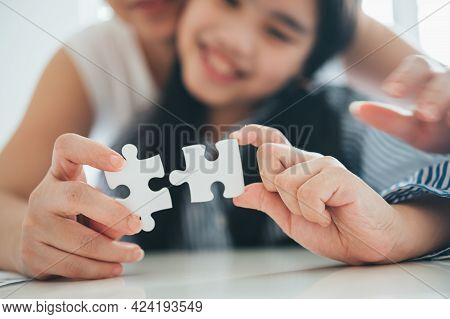 Happy Family, Asian Daughter Playing Jigsaw Puzzle With Her Mother For Family Concept, Adult Woman T