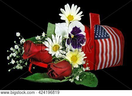 Flower Bouquet In Red Mailbox With American Flag Isolated On Black