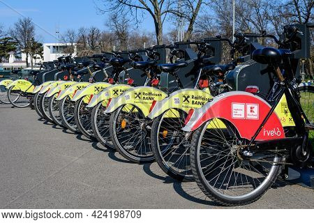 Bucharest, Romania, 3 April 2021: Public Bike Sharing Bicycles From Ivelo And Raiffeisen Bank In A D