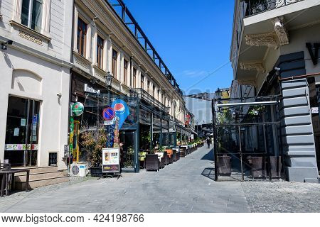 Bucharest, Romania - 3 May 2021: Old Buildings In The Historical Touristic Center In A Sunny Spring