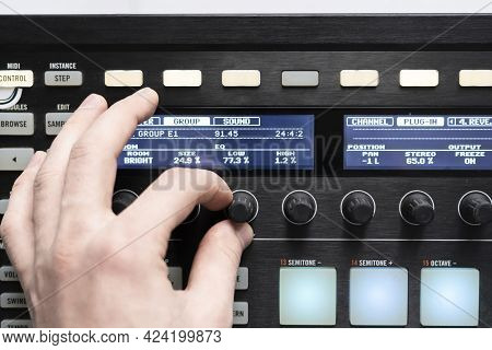 A Musician Hand Adjust Sound With Knob, Mix Electronic Music