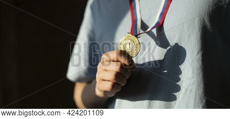 A Male Sportsman With A Golden Medal On A Chest, Champion Leader