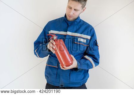 A Fireman Man Holding A Fire Extinguisher, Safe Work And Precautions Concept