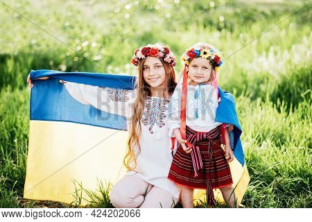 Ukraine's Independence Flag Day. Constitution Day. Ukrainian Two Girls In Embroidered Shirt Vyshyvan