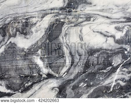 Black White Marble Texture In Opencast Mine. Mining Cliff Rough Surface. Template To Use As A  Backg
